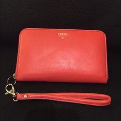 Fossil wristlet Brand new Fossil wristlet, orange color, 3 credit  card slots, phone slot for iPhone 5 or similar size. Fossil Bags Clutches & Wristlets