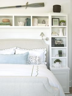 get this look using two Ikea skinny bookcases and an Ikea bridging shelf