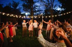 Backyard Engagement Party: A backyard gathering is the perfect backdrop for a family engagement celebration. Fire up the grill and start decorating!