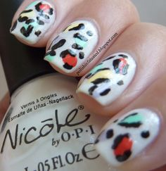 Rainbow leopard print nail art design - white shimmery base with bright color spots