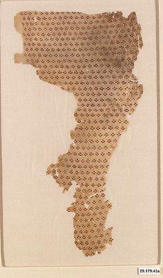 SIlk Fragment Object Name: Fragment Date: 11th–12th century Geography: Egypt Culture: Islamic Medium: Linen, silk; plain weave, brocaded