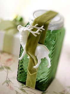 Sometimes all you need is a ribbon with a holiday garnish: http://www.bhg.com/christmas/gift-wrapping/last-minute-gift-wrapping/?socsrc=bhgpin120514garnishwithstyle&page=9