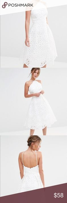 """NEW Chi Chi London High Neck Cutwork Midi Dress Size: UK 16. US 14. New with tags. Cut work lace, fully lined. Scalloped detailing, halter neck style. Regular fit, true to size. 40"""" long. Lovely detailed dress Chi Chi London Dresses Midi"""