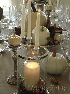 Fall table scape...I love the white pumpkins with the silver pieces...so elegant.