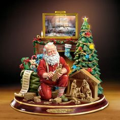"""The """"Thomas Kinkade's The True Meaning of Christmas Narrative Santa Figurine"""" is the first ever to feature the blessed Nativity and Thomas Kinkade's own voice, bringing the spirit of the holidays to life in words and sculpture.  It uniquely features an exceptionally lifelike Santa carving a Nativity inspired by the acclaimed artwork of Thomas Kinkade.  The tree and painting above the mantle all illuminate with the simple flip of a switch."""