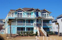 ROYAL PALM PARADISE I, #716 l Duck, NC - Outer Banks Vacation Rental Home l Semi-oceanfront home with six master suites, elevator, panoramic ocean views, gentleman's sports bar with billiard table and kitchenette, theater room, library with seasonal gas fireplace, private pool with waterfall and option to heat, in-ground hot tub, pool house with sauna and rooftop sun deck. l www.CarolinaDesigns.com