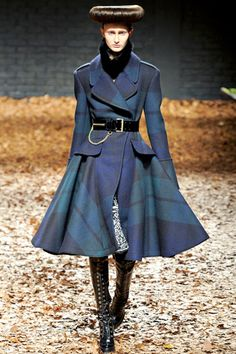 McQ Fall 2012 RTW. Giant plaid on giant coat. Dior's New Look meets Scotland meets.. well, more military. Yes, please.