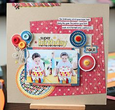 Super cute birthday layout by Kelly Noel. I love the buttons on the balloons, the way the paper is angled, and the little strip of paper at the top.
