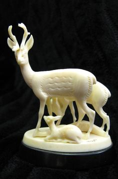 Souvenirs from Russia. Deer family figurines carved of a mammoth tusk. #travel