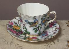Pretty vintage Old Royal bone china England Lorna Doone chintz pattern with blue bird tea cup and saucer