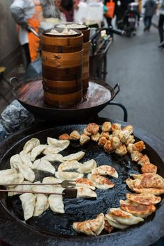 Chinese street food, pan fried dumplings.