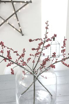 Simple display of berried twigs in clear glass vase; Christmas star made from branches and fairy lights Noel Christmas, Scandinavian Christmas, Christmas Is Coming, Little Christmas, Christmas And New Year, Winter Christmas, Christmas Crafts, Christmas Decorations, Xmas