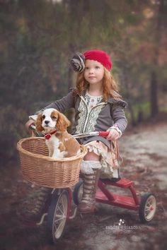 Child using a basket as a dog carrier on her bike.#kids #bikes