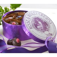 Rose & Violet Creams-  A quintessentially Victorian treat in every detail, from the hand-dipped sugared rose and violet petals, to the authentic 19th century lithograph featured on the label.