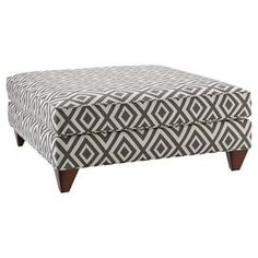 """Perfect for serving signature cocktails and hors d'oeuvres at your next soiree or resting a tray of fragrant candles in the living room, this cotton-upholstered ottoman showcases a diamond motif and square tapered legs.     Product: Cocktail ottomanConstruction Material: Cotton and woodColor: Graphite and espressoFeatures: Square tapered legsDiamond motifDimensions: 17"""" H x 38"""" W x 38"""" DAssembly: Assembly required"""