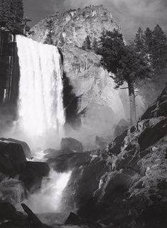 1948 Vernal Fall, Yosemite Valley, California [[falls at left, tree at right, rapids over rocks]] by Ansel Adams 77.14.6