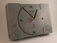 PlayStation Game Console Wall Clock. LOVE this, haha. Would look great in the game room :p