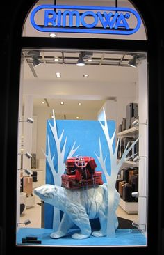 RIMOWA Winter Window Display 2012 in Prague --(would be great with a stack of books)