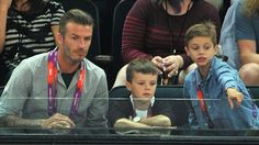 (L-R) David Beckham and his sons Cruz Beckham and Romeo Beckham during the Men's Basketball gold medal game between the United States and Spain on Day 16.