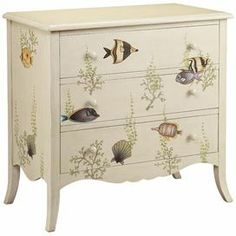 Hand-painted wood chest with a scalloped apron and a tropical fish motif.