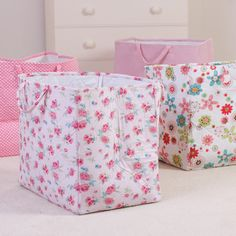 Pink printed fabric storage bags.  http://www.worldstores.co.uk/p/Babyface_Pink_Stripe_Storage_Bag.htm