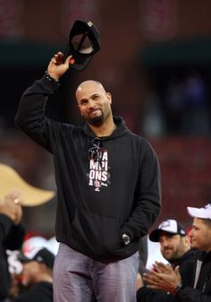 St. Louis Cardinals Albert Pujols salutes fans during the World Series Parade and Celebration Sunday October 30, 2011, at Busch Stadium in St. Louis, Mo.
