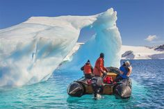 Tourists on a Zodiac exploring the icebergs of the Antarctic Peninsula © Patrick Endres / Getty Images-Article by Lonely Planet