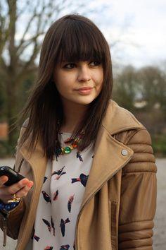cute bangs with cute jacket.
