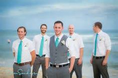 Groom with vest, groomsmen with white shirts and tie only