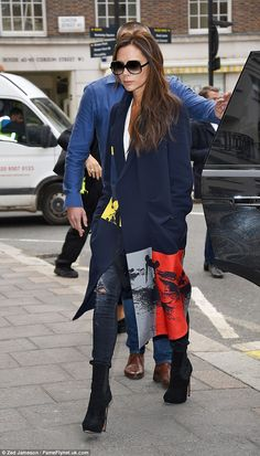 Victoria Beckham is stylish in navy coat as London Fashion Week begins #dailymail