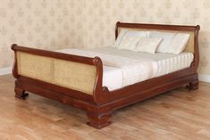 The Rattan French Sleigh Bed features Rattan panels in both the headboard and footboard. Handcrafted from solid Mahogany wood which is only sourced from sustainable plantations. Finished with a traditional wax polish to enhance the rich mahogany wood. Rattan Bed Frame, Rattan Headboard, Headboard And Footboard, Barrel Furniture, Bedroom Furniture, Mahogany Furniture, Sleigh Beds, Bed Styling