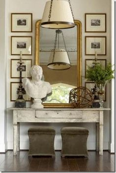 Flank large entry mirror with bird mounts or row deer antlers instead & large woven baskets under table.