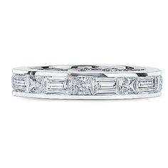 June Emerald Cut & Princess Cut Channel Set CZ Eternity Band... Our June eternity band features sideways channel set classic emerald cut alternating with princess cut cubic zirconia stones set all the way around the band. June measures approximately 4.0 millimeters wide and 2.5 millimeters deep. Carat weight runs between 5.5 - 6.5 carats total weight; actual carat weight varies per finger size. Available in 14K white gold or 14K yellow gold.