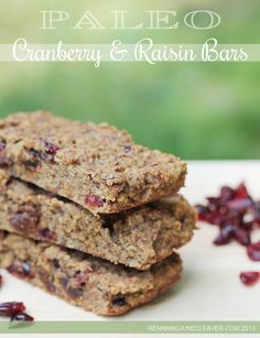 Paleo Cranberry Raisin Bars:      3 cups Almond MEAL (not blanched)     ½ tsp Sea Salt     1 tsp Cinnamon     ½ cup Organic, Raw Coconut Sugar (or ¼ cup honey)     4 Eggs     ⅓ cup Coconut Oil     ½ cup Dried, Whole Cranberries     ½ cup Raisins     ½ tsp Pure Vanilla Extract     ⅓ cup Crushed Hazelnuts (can use pecans, walnuts, etc).