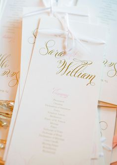 Blush pink and metallic gold wedding programs with ivory bows.