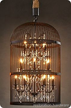 (Paul Michael has smilar birdcage without lights.) Great diy Restoration Hardware knock off lamp. Old birdcage, chandelier type lamp, some rope and lamp gems, some bronze paint. Birdcage Light, Birdcage Chandelier, Bottle Chandelier, Foyer Chandelier, Antler Chandelier, Cage Deco, Diy Luz, Deco Boheme Chic, Chandeliers