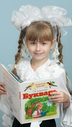 Russian school uniform. On special occasions little schoolgirls love to wear big white bows. 2011. #education