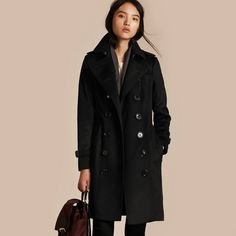 A Sandringham fit Burberry trench coat in Italian-woven cashmere. The unlined design is slim with a tapered waist and can be worn belted for a close fit or open and relaxed.