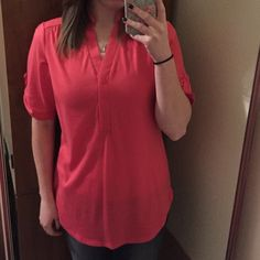 Coral high low Coral shirt, bought it without realizing the bottom button is missing, not very noticeable. Small snag on the top left. Tops Blouses
