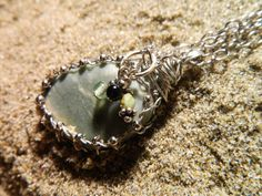 Wire wrapped beach rock by BeachinJewelry on Etsy, $35.00