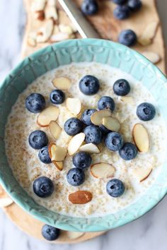 Blueberry Breakfast Quinoa - Start your day off right with this protein-packed quinoa breakfast bowl with a touch of tart sweetness from fre...