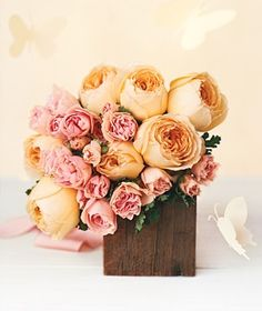 This pretty pouf of roses―giant garden blooms and rose geranium leaves (shown)―is simple but lush. Pale pinks, creams, and buttery yellows are a soft touch in sticky weather, and the hints of green pick up the grass outside.