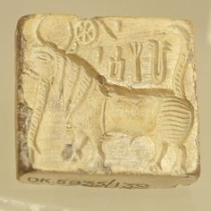 https://flic.kr/p/djf7oK | Seal -10, Harappan Civilization, C- 2700-2000 BC | Seals appear in the Indus Valley around 2600 B.C. with the rise of the cities and associated administrators. Square and rectangular seals were made from fired steatite. The soft soapstone was carved, polished, and then fired in a kiln to whiten and harden the surface. Seals made of metal are extremely rare, but copper and silver examples are known. The square seals usually have a line of script along the top and a…