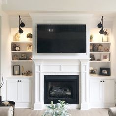 Home Remodeling Fireplace Gardenhire Swing Arm Lamp Living Room Decor Fireplace, Home Fireplace, Fireplace Remodel, Fireplace Surrounds, Fireplace Design, Fireplace Lighting, Fireplace Hearth, Fireplace Ideas, Built In Around Fireplace