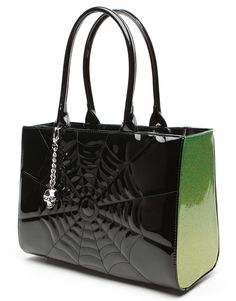 Elvira Lucky Me Tote Bag Black/Lime Green Spider Web By Lux De Ville at Inked Boutique.  Limited Edition Lucky Me Totes made just for Elvira Mistress of the Dark, feature a beautiful spiderweb stitching across the front and tuck and roll across the back, silver logo plate on the side and an over sized skull bauble with rhinestone eyes,  and small silver feet. Inside custom card suit lining with an inside pocket to stash all of your loot. These are limited edition and won't last long…