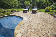 Clean and neat freeform paver patio by Red Valley Landscape & Construction in Norman, OK.
