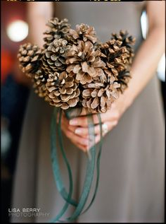 find different unique uses for things that are NATURALLY free. leaves, pine cones, rocks, sand, the list goes on & on. This blogger has tons of unique ideas for pine cones; centerpieces, boutonnieres, spice some at home and package them as scented potpourri favors for your guests, use in candlescapes, etc.