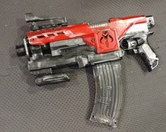 Nerf longshot painted gray with an 8 kg spring upgrade. Permanantly combined with a nerf brainsaw. Nerf Longshot, Modified Nerf Guns, Cool Nerf Guns, Nerf Darts, Nerf Mod, Borderlands Art, Mandalorian Cosplay, Hand Guns, Weapons