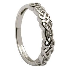 Idea for wedding band......Ladies Celtic Knot Wedding Ring with Diamonds by Shanore