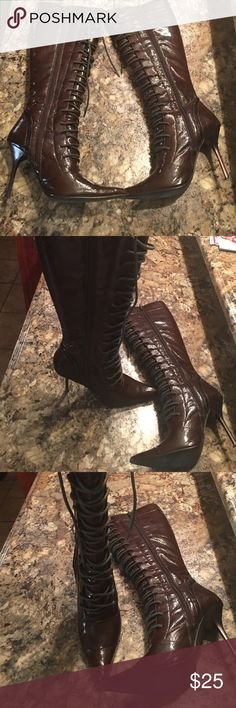 Brown string stilettos boots Boots are brown that have laces up the front. Boot zips on the side. Boot has small imperfection which is featured in pic 4. Has been worn but in good condition Michael Antonio Shoes Lace Up Boots